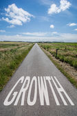 Cloudscape above country road with text growth — Stock fotografie