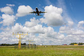 Unidentified plane on landing approach at amsterdam airport — Stock Photo