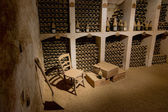 Wine cellar with old wine bottles — Stock Photo