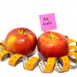 Stock Photo: Apple with measuring tape, Calorie content