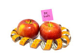 Apple with measuring tape, Calorie content — Stock Photo