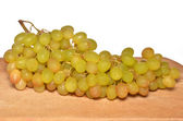 Grapes on wooden board — Stock Photo