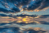 Sun reflection at sunset sunrise over the water — Stock Photo