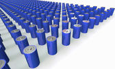 An Array of blue batteries isolated on white — Stockfoto