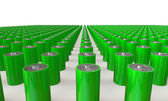 An Array of green batteries isolated on white — Stock Photo