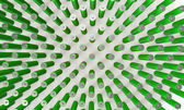An Array of green batteries isolated on white — Stockfoto