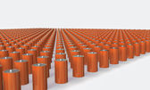 An Array of orange batteries isolated on white — Stockfoto