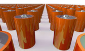 An Array of orange batteries isolated on white — Stock Photo