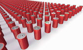 An Array of red batteries isolated on white — Stock Photo