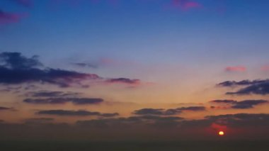 Timelapse movie of clouds at sunset above the sea — Stock Video