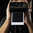 Photographer with a instant camera — Stock Photo