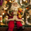 Santa in front of a Christmas tree — Stock Photo