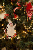 Snowman hanging on a Christmas tree — Stock Photo
