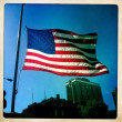 The American Flag flying at half mast in respect to the memory of the victims of the Boston bombings 2013. — Stock Photo