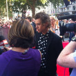 Harry Styles from 1 Direction being interviewed at the world premier of the 1Direction film in Londons Leicester Square — Stock Photo