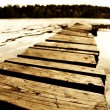 Wooden pier at lth Rusian lake. — Stock Photo