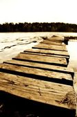 Wooden pier at lth Rusian lake. — Foto de Stock