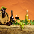 Stock Photo: Red and white wine bottle with white and grapes