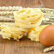 Fresh egg and noodles on white background — Stock Photo