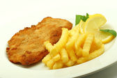 Cutlet with french fries — Stock Photo