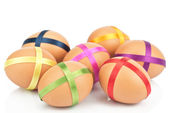 Eggs with ribbon isolated on white — Stock Photo