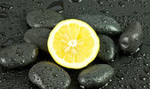 Spa composition with stones and lemon — Stock Photo