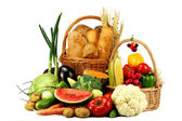 Baskets with fresh vegetables and bakery — Stock Photo