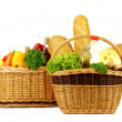 Basket with fresh vegetables and bakery — Stock Photo