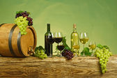 Red and white wine bottle with grapes — Stock Photo