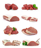 Pieces of fresh meat on a white background — Stock Photo