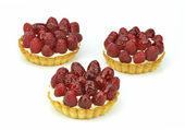 Cakes with raspberries on a white background — Stock Photo