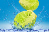 Green Cabbage falling in water — Stock Photo