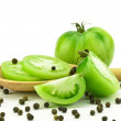 Green tomatoes with spoon — Stok fotoğraf