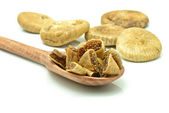 Wooden spoon with figs — Stock Photo