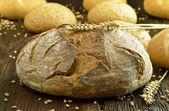 Black bread and buns — Stock Photo