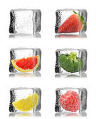 Ice cubes with fruits and vegetables inside — Stock Photo