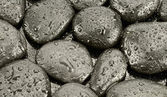 Black pebble stones background — Stock Photo