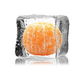 Orange in ice cube — Stock Photo