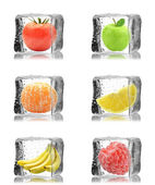 Fruits, berries with tomato in ice cubes — Stock Photo