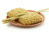 Wholemeal bread rolls on a plate — Stock Photo