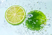 Lime with water splash — Stock Photo
