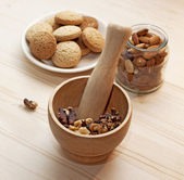 Mortar with walnuts, cookies and almonds — Stock Photo