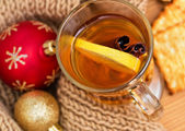 Hot drink with a lemon and cinnamon — Stock Photo