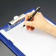 Woman's hand pen and notepad — Stock Photo
