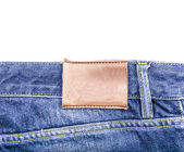 Blank leather label on blue jeans — Stock Photo