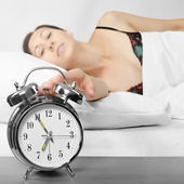 Woman turning off her alarm clock — Foto Stock