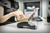 Bank terminal and tablet pc — Stock Photo