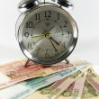 Alarm on a white backround with money — Stock Photo