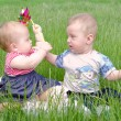 Little boy and girl playing on green grass — Stock Photo