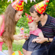 Stock Photo: Family celebrating first birthday of their beloved daughter